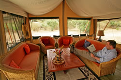 Relaxing at JK Mara Camp. Copyright Bill Gozansky